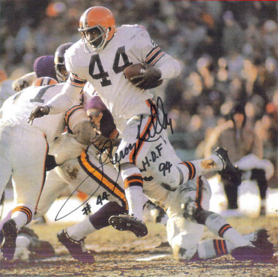 Autographed Photo of Leroy Kelly running with the help of a block by Dick Schafrath