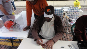 Leroy Kelly signing his rookie card for me with Ernie Green looking over his shoulder